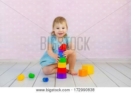 Child playing with blocks in the kindergarten.