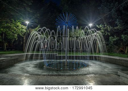 Water fountain illuminated with lights at night