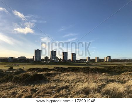 ABERDEEN - FEBRUARY 23, 2017: Residential tower blocks next to a links golf course along the Esplanade at the seafront in Aberdeen, Aberdeenshire, Scotland, UK.