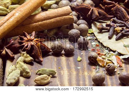 various spices on a wooden brown background