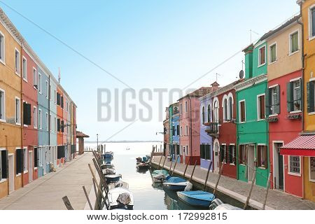 Colorful facade house on island of Burano canal street