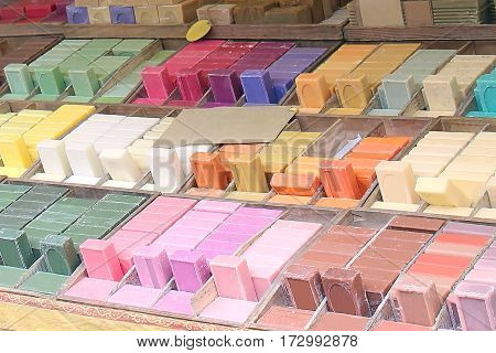 Organic colorful natural soaps on market stall