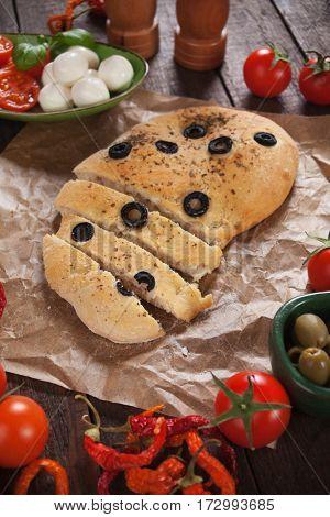 Italian focaccia bread similar to pizza with black olives