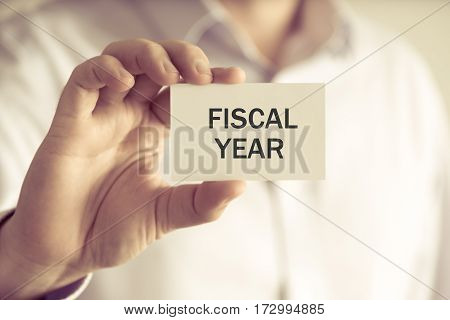 Businessman Holding Fiscal Year Message Card