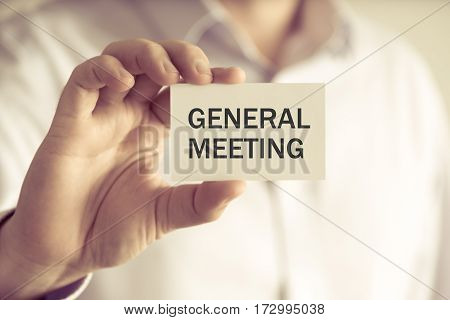 Businessman Holding General Meeting Message Card