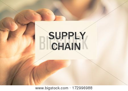 Businessman Holding Supply Chain Message Card