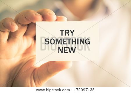 Businessman Holding Try Something New Message Card