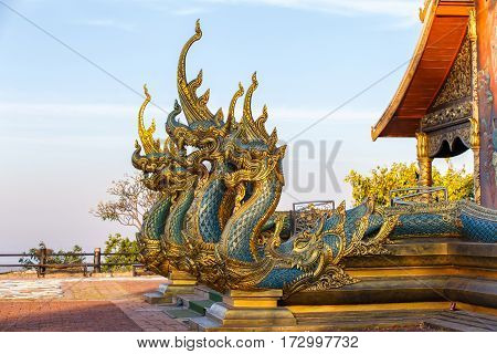 Close up head of Naka or serpent statue opening mouth with Temple Phu Proud at Sirindhorn District Ubon Ratchathani Province Thailand