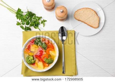Bowl with vegetable soup on green napkin