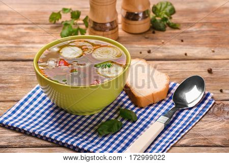Bowl with vegetable soup on kitchen table