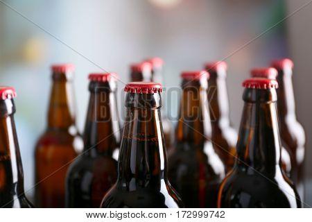 Bottles of beer on blurred background