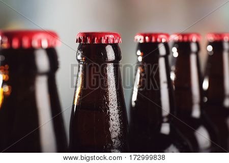 Bottles of beer on blurred background