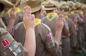 Asian boy scouts oath explained in camp activities as part of the study. Boy scout sign concept. poster