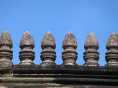 Roof details of Ancient Khmer Temple against vibrant blue sky, Phanom Rung Historical Park, Thailand poster
