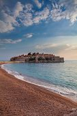 view of beauty sunset over Sveti Stefan small islet and resort in Montenegro. Balkans Adriatic sea Europe. poster