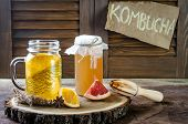Homemade fermented raw kombucha tea with different flavorings. Healthy natural probiotic flavored drink. Copy space poster