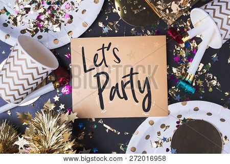 Let's Party Brush Stroke Handwriting On Golden Greeting Card With Party Cup,party Blower,tinsel,conf