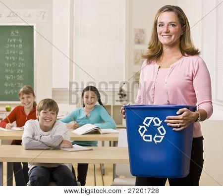 Teacher holding recycling bin