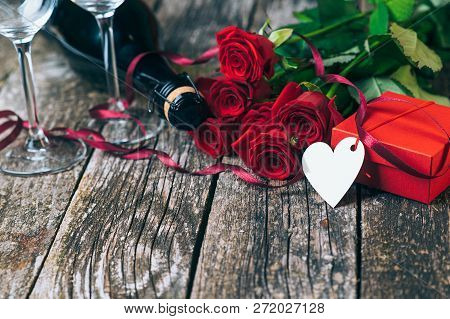 Valentines Day Background. Beautiful Red Roses. Valentines Gift With Flowers. Champagne Glasses And