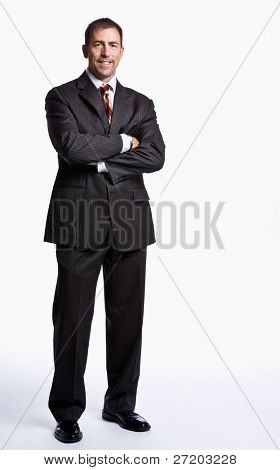 Businessman smiling with arms crossed