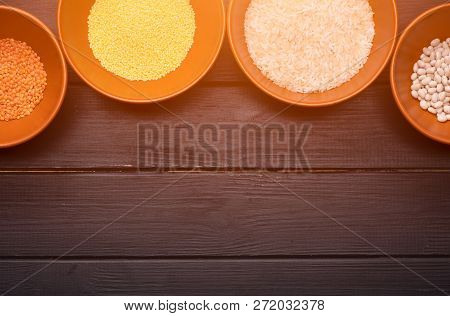 Cereal In Clay Plates On A Wooden Table.