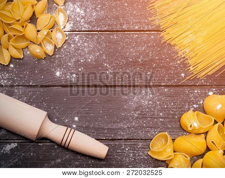 Variety Of Pasta On The Kitchen Wooden Table