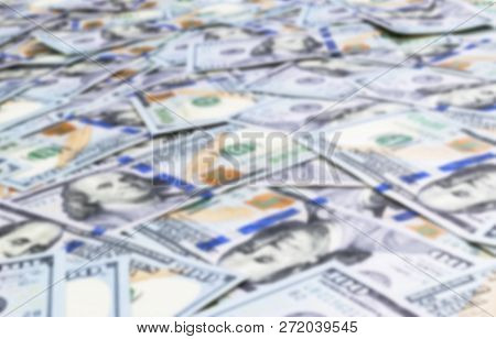 Blurred Background With Stack Of One Hundred Dollar Bills. Blur Stack Of Cash Money In Hundred Dolla