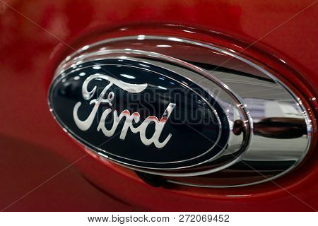 Kropivnitskiy, Ukraine  - 27 September, 2018: Close Up Ford Logo On New Red Car At Motor Show, Autom