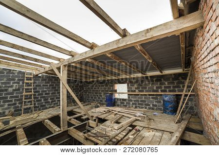 Two-storied Building Under Construction And Renovation. Perspective View Of Energy Saving Walls Of L