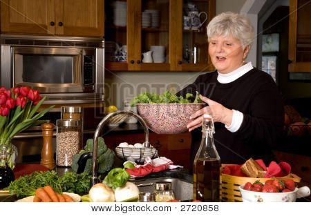 Mature Woman Preparing Greens.