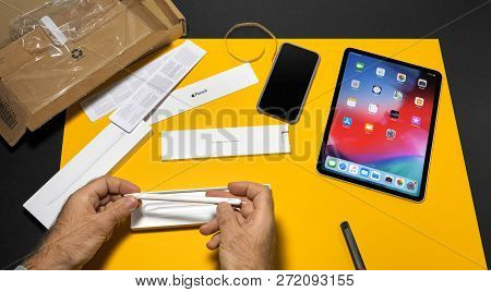 Paris, France - Nov 16, 2018: Man Unboxing Preparing Apple Pen 2 For Latest Ipad Pro Smart Tablet De