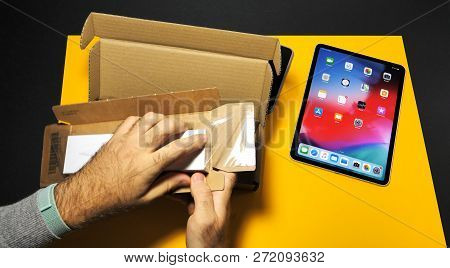 Paris, France - Nov 16, 2018: Man Removing From The Box The Apple Pencil 2 Manufactured By Apple Com