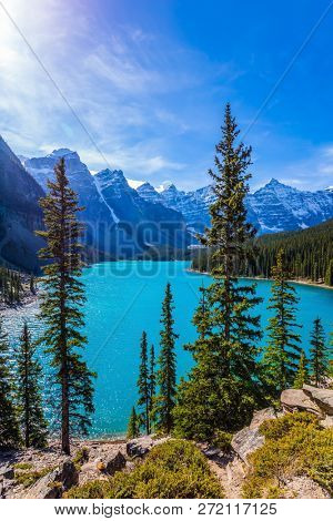 Canadian Rockies, Province of Alberta. Lake Moraine with emerald water in the Valley of the Ten Peaks. The concept of ecological, photographic and active tourism