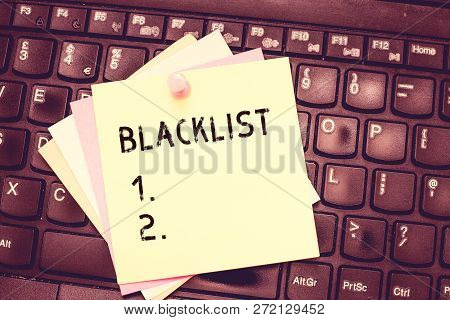 Conceptual hand writing showing Blacklist. Business photo text list of showing or groups regarded as unacceptable or untrustworthy Blank Notepad Sheet with Push Pin for Reminding on Laptop keyboard. poster
