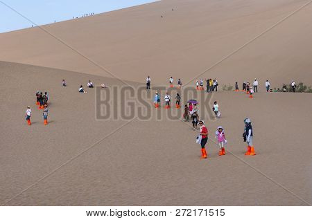 Dunhuang, China - August 8, 2012: Group Of Chinese Tourists At The Crescent Moon Lake Near The City