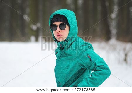 Portrait Of A Female Cyclist Athlete In The Winter Forest. Cyclist On Cyclocross Bike Trails In The