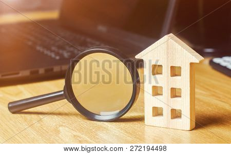 Wooden House And Magnifying Glass. Property Valuation. Choice Of Location For The Construction. Hous