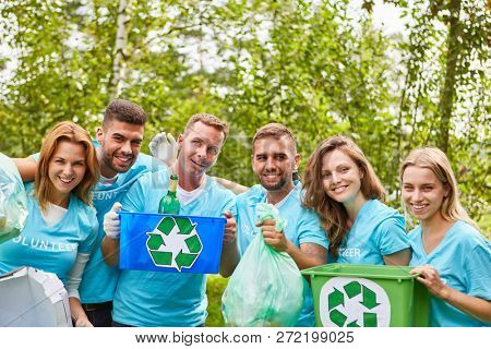 Young people as environmentalists collect waste for reuse and recycling