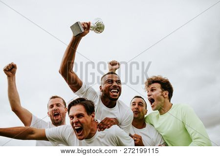 Soccer players team celebrating their victory