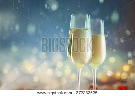 Christmas Background. Golden Holiday Abstract Defocused Background With Glowing Stars. New Year Cham
