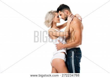 Heterosexual Couple Hugging And Looking At Each Other Isolated On White