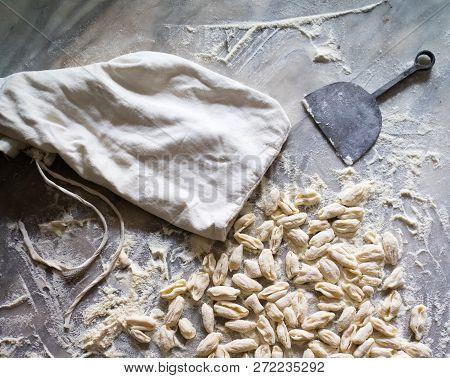 Making Fresh Pasta. Cavatielli. Italian Traditional Fresh Homemade Pasta On A Marble Table