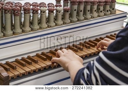 Eupen, Belgium - October 09, 2016: The Hands Of An Unidentified Boy On The Keyboard Of A Regal, Open