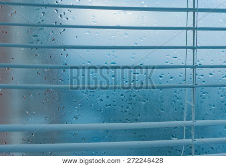 Water Drops From Home Condensation On A Window. Misted Glass Background. Strong Humidity In Winterti
