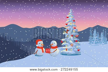 Winter Boxing Day With Snowmen. Evening Twilight With Snowman Family In Santa Hat, Distant Mountains