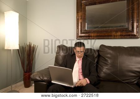 Home Or Office - Businessman Working On The Couch