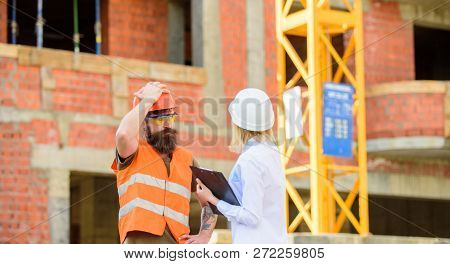Discuss progress project. Inspector and bearded brutal builder discuss construction progress. Construction project inspecting. Construction inspection, corrections and fines. Safety inspector concept poster
