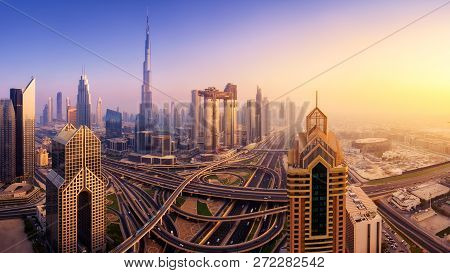 Dubai Skyline At Sunset, Panoramic Aerial Top View To Downtown City Center Landmarks. Famous Viewpoi