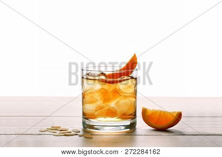 Godfather Cocktail With Orage And Alcohol. Glass With Orange Cocktail