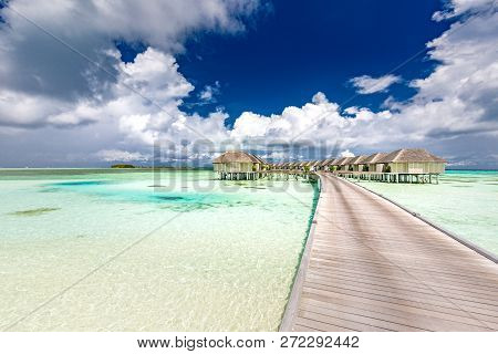 Luxurious Wooden Outdoor Over Water Villas And Spa On A Tropical Atoll In Maldives. Exotic Vacation